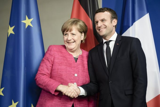 http://www.businesstimes.com.sg/government-economy/macron-wins-merkel-backing-for-bid-to-shake-up-europe